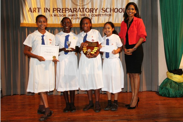 The Hon. Lisa Hanna presents the K. Wilson Shield to the winners of the Best Overall category to Immaculate Preparatory. ~1